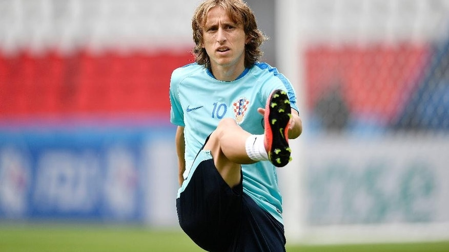 Croatia's Luka Modric exercises during a training session at the Parc des Princes stadium in Paris, France, Saturday, June 11, 2016. Croatia will face Turkey in a Euro 2016 Group D soccer match in Paris on Sunday, June 12, 2016. (AP Photo/Martin Meissner)