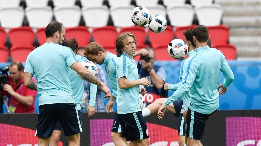 Croatia's Luka Modric, center, exercises with the ball during a training session at the Parc des Princes stadium in Paris, France, Saturday, June 11, 2016. Croatia will face Turkey in a Euro 2016 Group D soccer match in Paris on Sunday, June 12, 2016. (AP Photo/Martin Meissner)