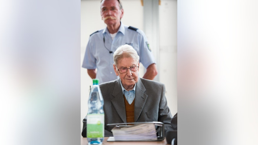 94-year-old former SS guard at the Auschwitz death camp Reinhold Hanning,  arrives at  a courtroom in Detmold, Germany,  Saturday June 11, 2016. A defense lawyer is calling for the acquittal of a 94-year-old former Auschwitz death camp guard being tried in Germany as an accessory to murder.   In closing arguments Saturday, defense lawyer Johannes Salmen said the trial at the Detmold state court produced no evidence that  Reinhold Hanning was directly involved in specific crimes, news agency dpa reported. He said Hanning never killed or beat anyone. (Bernd Thissen/Pool Photo via AP)