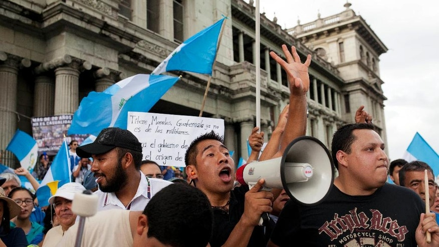 Demonstrators chant against corruption outside the National Palace in Guatemala City, Saturday, June 11, 2016. Protesters gathered at Plaza Central to demand justice in the new cases of corruption against former President Otto Perez Molina and Vice President Roxana Baldetti. Both politicians are jailed and awaiting trial in multiple corruption cases. (AP Photo/Moises Castillo)