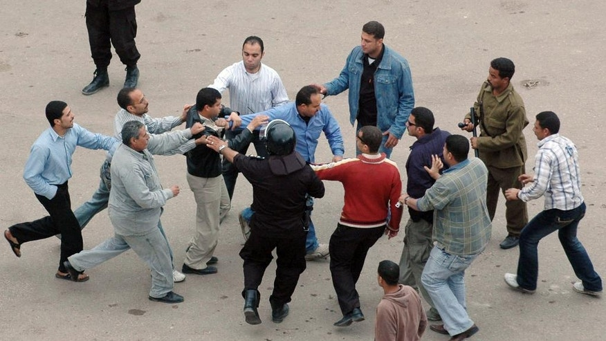 File - In this Sunday, April 6, 2008 file photo, Egyptian plainclothes policemen arrest a protester following clashes at Mahalla el-Kobra, Egypt. Former President Hosni Mubarak kept a tight lid on labor unrest during most of his 30 years in power, permitting only state-controlled unions in a tradition dating back to the days of socialist leader Gamal Abdel Nasser. But the independent unions began holding protests in the twilight years of Mubarak's reign, and workers assumed a major role in the 2011 uprising that ended it. (AP Photo, File)