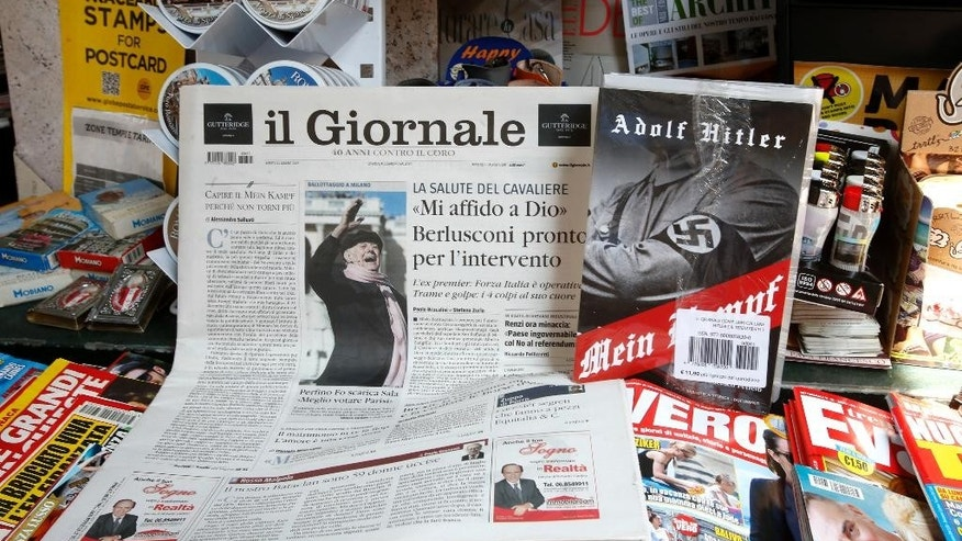 "Il Giornale newspaper is seen on sale in a newsstand with Hitler's ""Mein Kampf"", in Rome Saturday, June 11, 2016. The conservative Milan daily Il Giornale  has published Hitler's political manifesto ''Mein Kampf,'' angering Italy's premier and the tiny Jewish community. (AP Photo/Fabio Frustaci)"