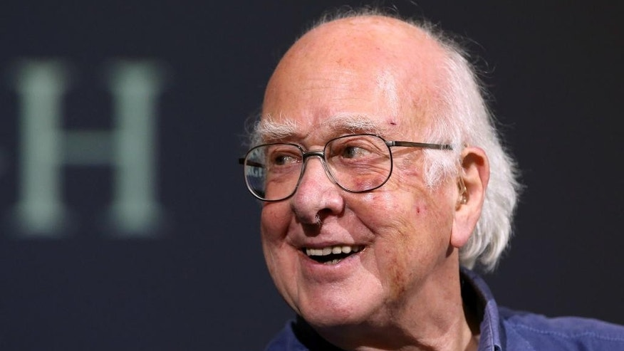 FILE - In this file photo dated Friday, Oct. 11, 2013, Britain's Professor Peter Higgs smiles during a press conference in Edinburgh, Scotland, Friday, Oct. 11, 2013.  A group of 13 Nobel laureates, including Peter Higgs, have written an open letter published in a British national newspaper Saturday June 11, 2016, urging U.K. referendum voters to remain inside the European Union, warning that Britain will lose funding, global influence and access to expertise if the nation votes to leave the 28-nation bloc.(AP Photo/Scott Heppell, FILE)