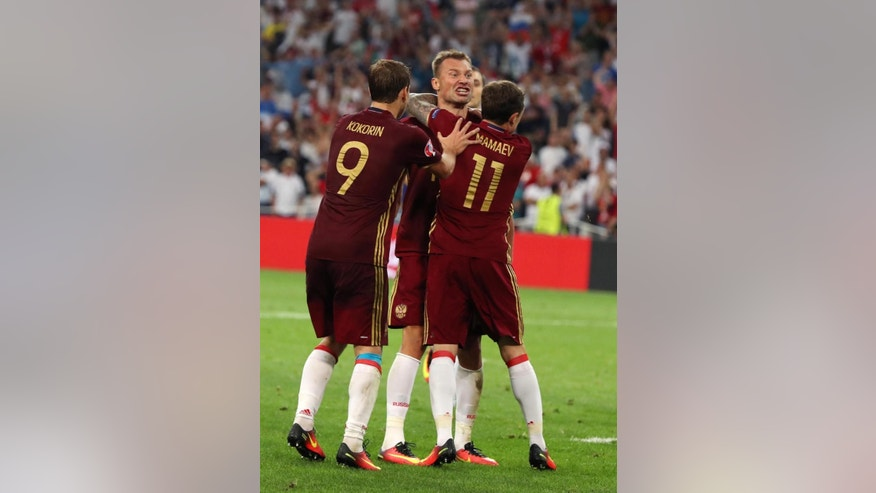Russia's Vasili Berezutski celebrates with teammates after scoring during the Euro 2016 Group B soccer match between England and Russia, at the Velodrome stadium in Marseille, France, Saturday, June 11, 2016. (AP Photo/Thanassis Stavrakis)