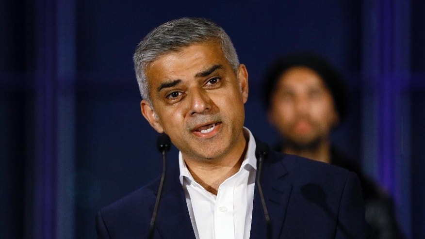FILE - In this file photo dated Saturday, May 7, 2016, Sadiq Khan, speaks on the podium at City Hall in London, Saturday, May 7, 2016.  London's mayor, Khan on Sunday June 12, 2016, pledged to fight until the moment the polls close to persuade Britons to vote to remain inside the European Union bloc, in the upcoming June 23 referendum.(AP Photo/Kirsty Wigglesworth, FILE)