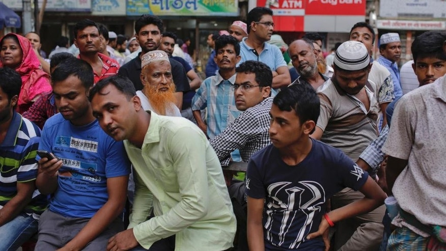 Relatives wait to meet prisoners outside the Dhaka Central Jail in Dhaka, Bangladesh, Sunday, June 12, 2016. Police in Bangladesh said Sunday that they have arrested more than 5,000 criminal suspects in the past few days as they continue a nationwide crackdown to try and stop a growing wave of brutal attacks on minorities and activists. (AP Photo)