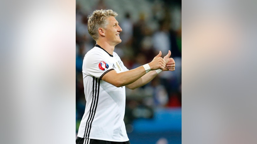 Germany's Bastian Schweinsteiger gives a thumbs up at the end of the Euro 2016 Group C soccer match between Germany and Ukraine at the Pierre Mauroy stadium in Villeneuve d'Ascq, near Lille, France, Sunday, June 12, 2016. (AP Photo/Michael Probst)
