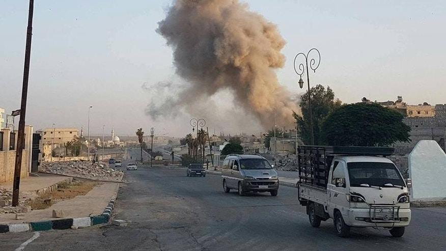 This photo taken on June 4, 2016 provided by the Syrian Civil Defense Directorate in Liberated Province of Aleppo, which has been authenticated based on its contents and other AP reporting, shows smoke rise from a warplane bomb that attacked Bab Neirab area, in Aleppo, Syria. After four years of grinding battles, Aleppo's divided residents face a common fear as the prospect of a total siege looms. Syria's largest city used to be its economic locomotive, now it is has become an emblem of its stalemated civil war. (Civil Defense Directorate in Liberated Province of Aleppo via AP)