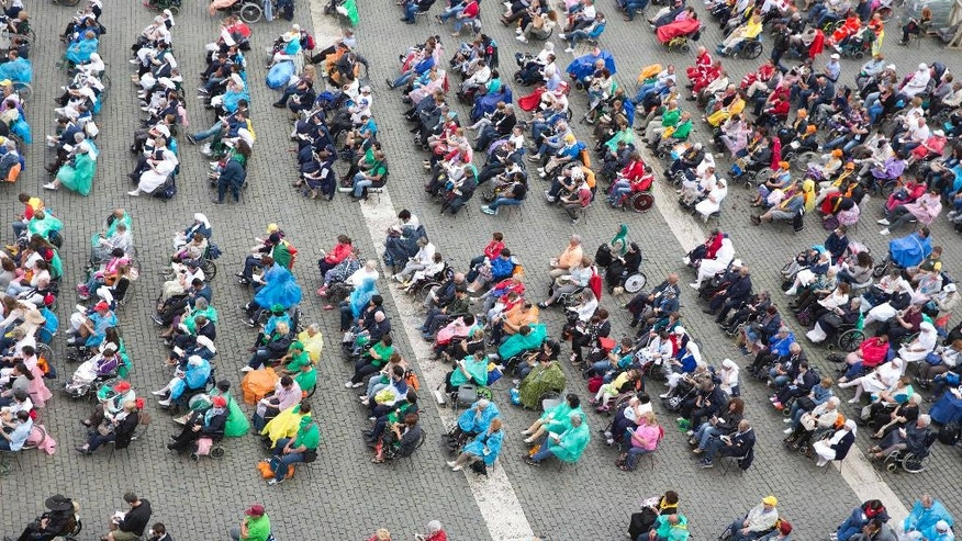 Disabled and sick people wait for Pope Francis arrival for a jubilee mass in St. Peter's Square at the Vatican Sunday, June 12, 2016. (AP Photo/Alessandra Tarantino)