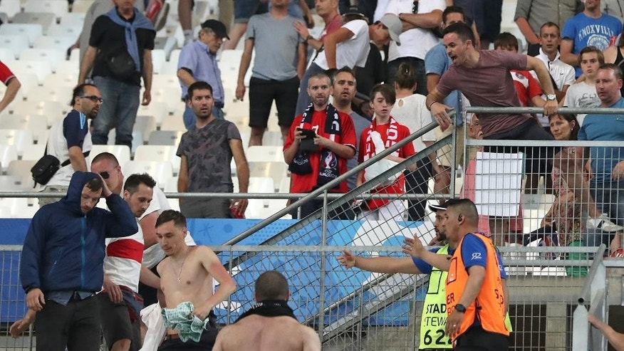 Stewards speak to supporters after clashes broke out in the stands during the Euro 2016 Group B soccer match between England and Russia, at the Velodrome stadium in Marseille, France, Saturday, June 11, 2016. (AP Photo/Thanassis Stavrakis)