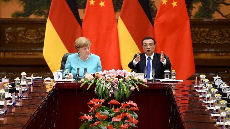German Chancellor Angela Merkel, left, listens to Chinese Premier Li Keqiang during a meeting at the Great Hall of the People in Beijing, Monday, June 13, 2016. Merkel is on a three-day visit to China. (Wang Zhao/Pool Photo via AP)