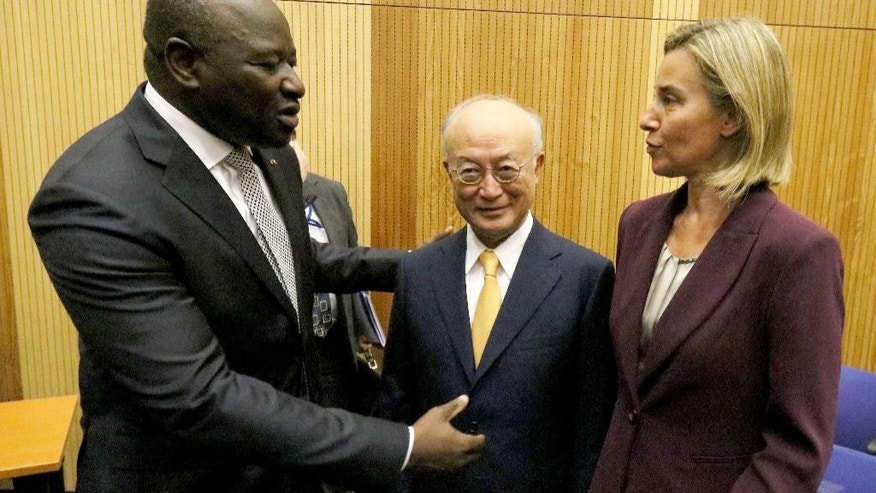 Lassina Zerbo, Executive Secretary of the Comprehensive Nuclear-Test-Ban Treaty Organization, CTBTO, Director General of the International Atomic Energy Agency, IAEA, Yukiya Amano of Japan and E.U foreign policy chief Federica Mogherini, from left, talk before the 20th anniversary celebration of the CTBTO, starts at the UN headquarters in Vienna, Austria, Monday, June 13, 2016. (AP Photo/Ronald Zak)