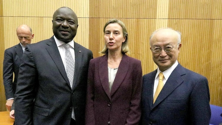 Lassina Zerbo, Executive Secretary of the Comprehensive Nuclear-Test-Ban Treaty Organization, CTBTO, EU foreign policy chief Federica Mogherini and Director General of the International Atomic Energy Agency, IAEA, Yukiya Amano, from left, pose for photos before the 20th anniversary celebration of the Comprehensive Nuclear Test Ban Treaty Organization, CTBTO, starts at the UN headquarters in Vienna, Austria, Monday, June 13, 2016. (AP Photo/Ronald Zak)