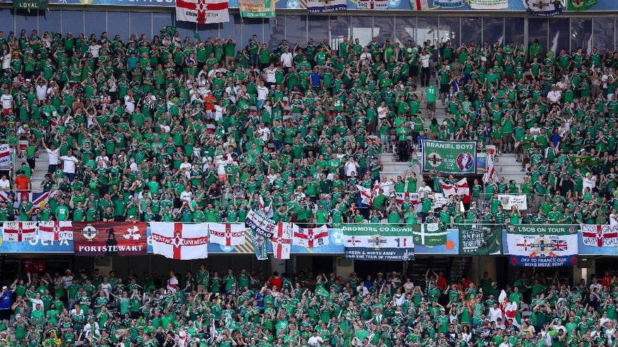 Northern Ireland fans sit in the stands prior  to the Euro 2016 Group C soccer match between Germany and Ukraine at the Pierre Mauroy stadium in Villeneuve d'Ascq, near Lille, France, Sunday, June 12, 2016. (AP Photo/)
