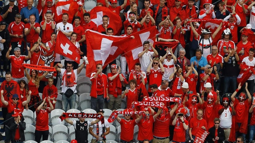 Albanian and Swiss fans mix at the end of the Euro 2016 Group A soccer match between Albania and Switzerland, at the Bollaert stadium in Lens, France, Saturday, June 11, 2016. Switzerland won 1 - 0. (AP Photo/Darko Vojinovic)