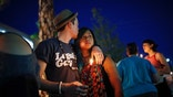 Two people embrace during a vigil at The Center, a community center for the LGBT community, Sunday, June 12, 2016, in Las Vegas. The vigil was for the victims of the Pulse nightclub shooting in Orlando. (AP Photo/John Locher)