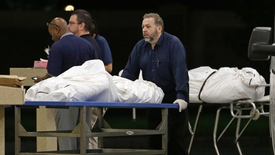 Two bodies of victims arrive at the Orlando Medical Examiner's Office, Sunday, June 12, 2016, in Orlando, Fla.