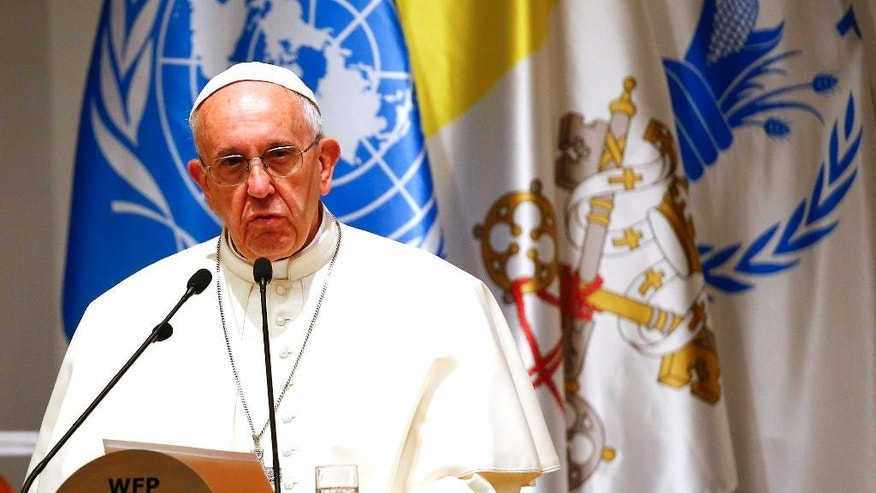 "Pope Francis delivers his speech during a visit to the United Nations World Food Program headquarters in Rome,  Monday, June 13, 2016.  Pope Francis said it is a ""strange paradox"" that food often cannot get through to those suffering due to war but weapons can. (Tony Gentile/ Pool Photo vi AP)"