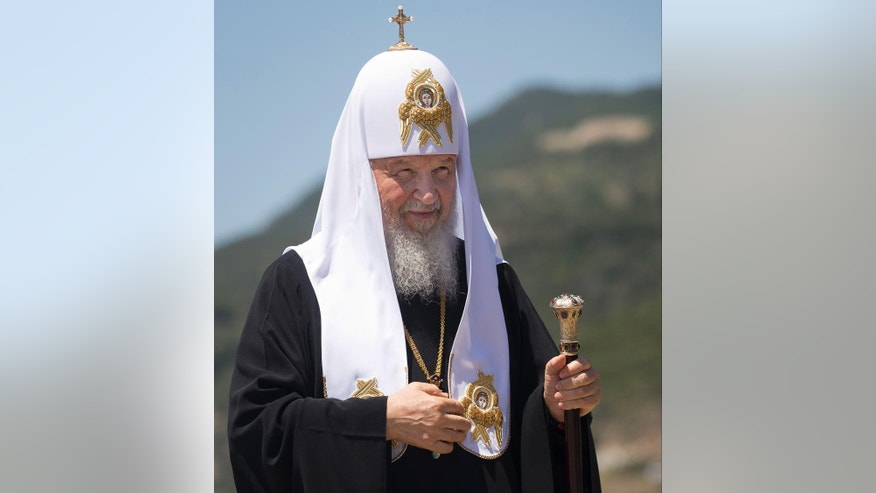 FILE - In this Friday, May 27, 2016 file photo, Patriarch Kirill of Moscow arrives to the port of Dafni, at Mount Athos, Greece. The Russian Orthodox Church on Monday, June 13, 2016, is suggesting postponing a historical meeting of all of the world's Orthodox churches. The meeting on the Greek island of Crete later this month could be the first one in more than a millennium. (AP Photo/Darko Bandic, FILE)