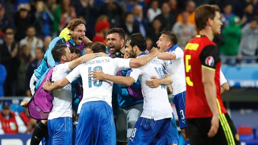 Italy's players celebrate their 2-0 win at the end of the Euro 2016 Group E soccer match between Belgium and Italy at the Grand Stade in Decines-Charpieu, near Lyon, France, Monday, June 13, 2016. (AP Photo/Laurent Cipriani)