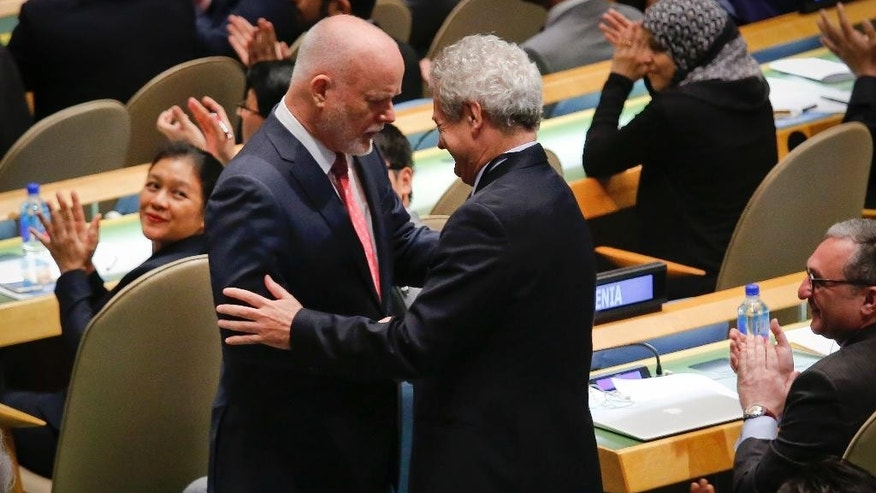 Fiji U.N. Ambassador Peter Thomson, left, receives congratulations from Cyrus Ambassador Andreas Mavroyiannis after being elected the new president of the U.N. General Assembly, Monday June 13, 2016, at U.N. headquarters. (AP Photo/Bebeto Matthews)