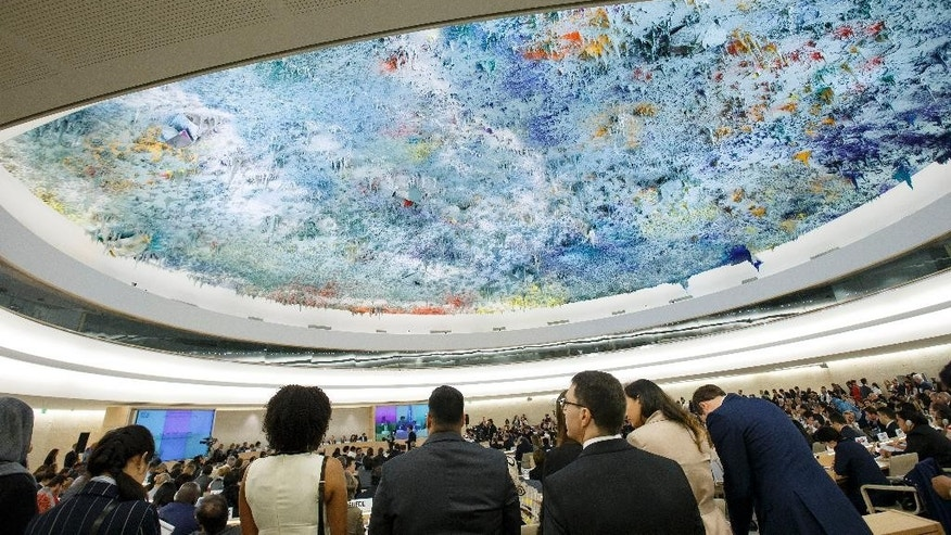 Delegates gather  during the opening of the 32th session of the Human Rights Council, at the European headquarters of the United Nations in Geneva, Switzerland, Monday, June 13, 2016.  (Salvatore Di Nolfi/Keystone via AP)