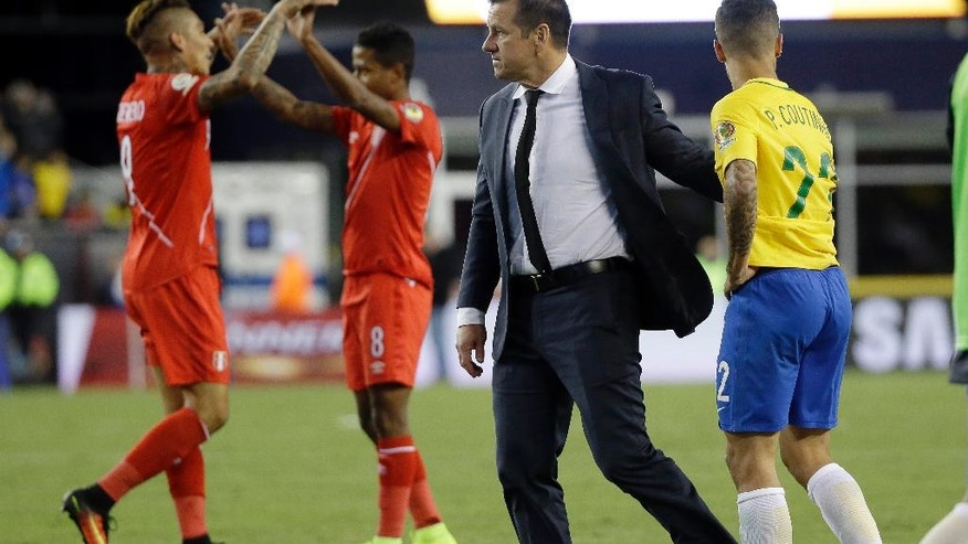 Brazil's head coach Dunga, second from right, and Philippe Coutinho (22) leave the pitch after a 1-0 loss to Peru as Peru's Paolo Guerrero, left, and Andy Polo celebrate after a Copa America Group B soccer match on Sunday, June 12, 2016, in Foxborough, Mass. (AP Photo/Elise Amendola)