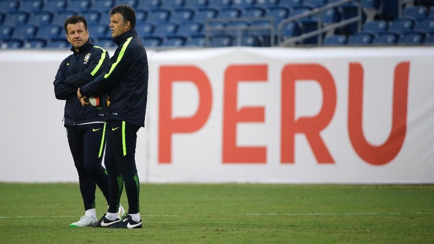 Brazil's head coach Dunga, left, speaks to technical director Gilmar Rinaldi during a Copa America Group B soccer practice at Gillette Stadium, Saturday, June 11, 2016, in Foxborough, Mass. Brazil faces Peru on Sunday in a Group B match. (AP Photo/Elise Amendola)