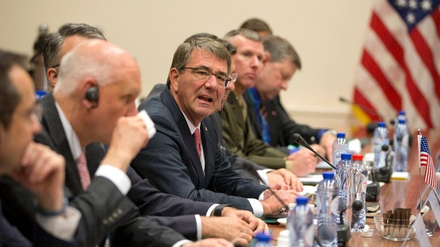 U.S. Secretary of Defense Ash Carter, center left, speaks during a meeting at NATO headquarters in Brussels on Tuesday, June 14, 2016. NATO's chief says the alliance will agree this week to send four multinational battalions to the Baltic states and Poland to boost their defenses against Russia. (AP Photo/Virginia Mayo, Pool)