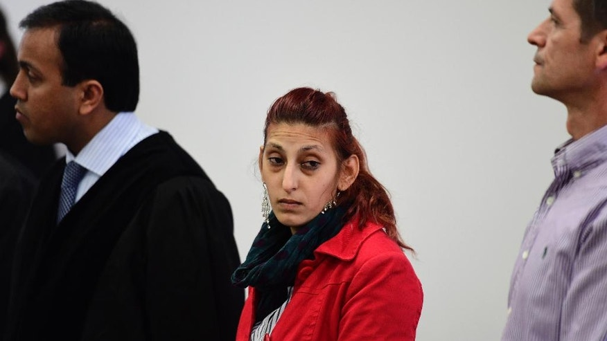 Mohamed's mother, Aldiana, center,  arrives for the start trial against Silvio S. at the regional court in Potsdam, near Berlin, on  Tuesday June, 14, 2016, as he is accused of abusing and killing her son. Silvio S is suspected of murdering two boys, Elias and Mohamed, a four-year-old  refugee  child he kidnapped from the chaotic grounds of Berlin's main refugee registration center LaGeSo. (John Mac Dougall/Pool Photo via AP)