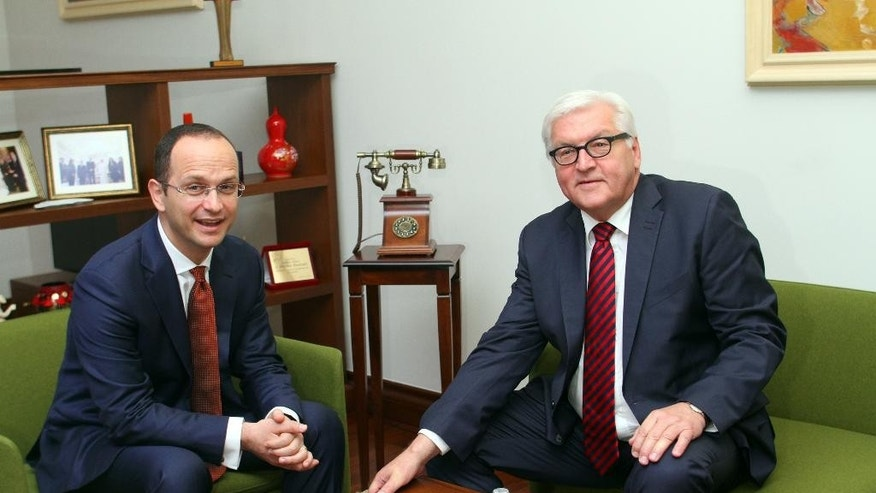 Visiting German Foreign Minister Frank-Walter Steinmeier, right, and host Albanian counterpart Ditmir Bushati hold talks in the Albanian capital, Tirana, Tuesday, June 14, 2016. Steinmeier called on Albania to pass a judicial reform package, considered fundamental to convince the European Union launch membership negotiations.  (AP Photo/Hektor Pustina)