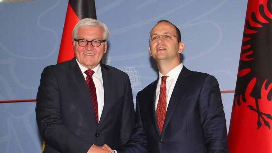 Visiting German Foreign Minister Frank-Walter Steinmeier (L) meets with host Albanian counterpart Ditmir Bushati in the Albanian capital, Tirana, Tuesday, June 14, 2016. Steinmeier called on Albania to pass a judicial reform package, considered fundamental to convince the European Union launch membership negotiations.  (AP Photo/Hektor Pustina)