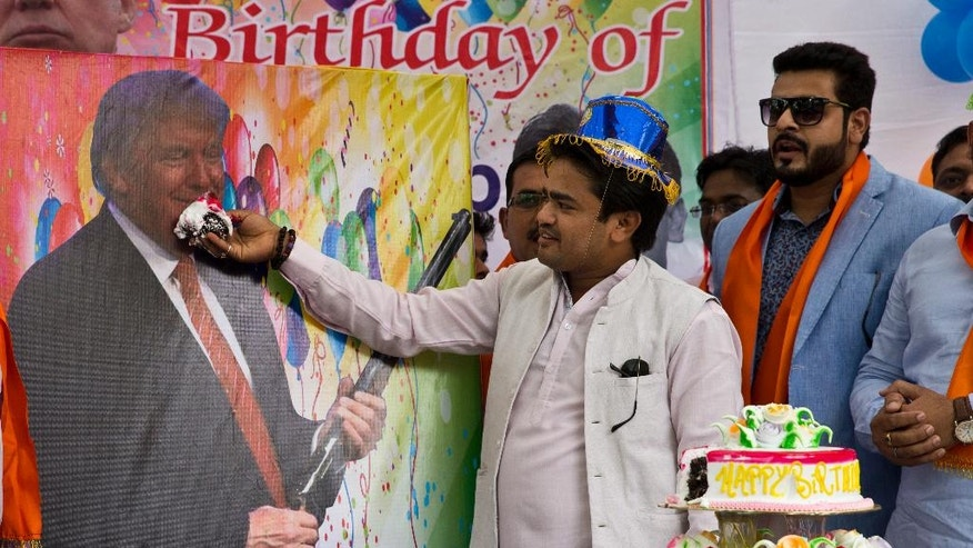 Members of the Hindu nationalist party 'Hindu Sena' or Hindu Army, celebrate the birthday of U.S. presidential candidate Donald Trump in New Delhi, India, Tuesday, June 14, 2016. The political group had earlier performed Hindu rituals to ensure Trump's presidential win and to solve the growing problems of Islamic terrorism. (AP Photo/Saurabh Das)