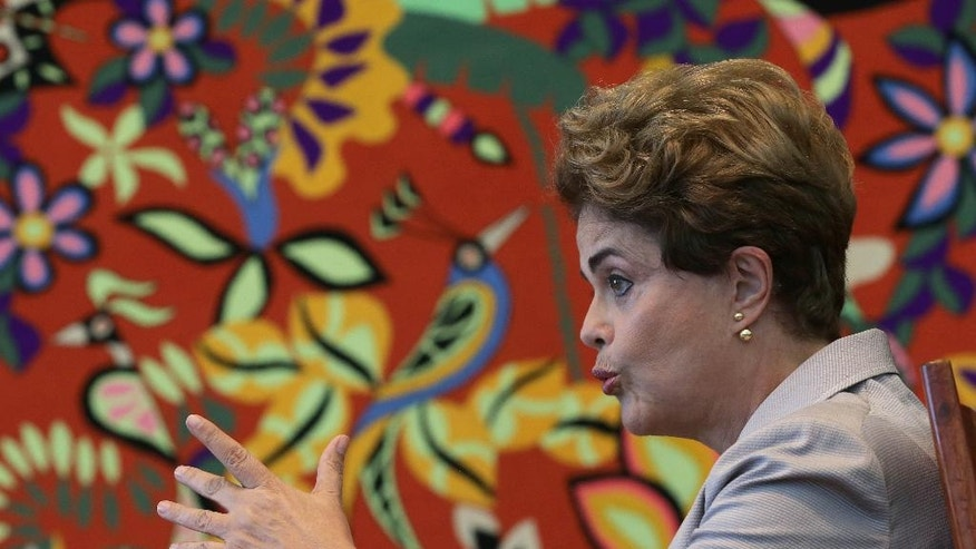 """Suspended Brazilian President Dilma Rousseff speaks during a press conference for foreign journalists at the Planalto residential palace, in Brasilia, Brazil, Tuesday, June 14, 2016. Rousseff blasted the impeachment process against her as """"fraudulent"""" and promised to fight what she characterized as an injustice more painful than the torture she endured under a past military dictatorship. (AP Photo/Eraldo Peres)"""