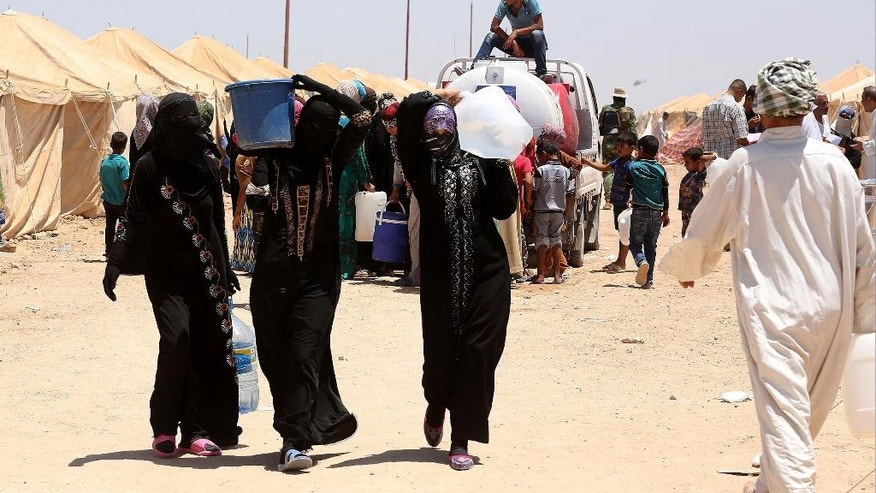 Internally displaced Iraqis at a camp outside Fallujah, Iraq, Monday, June 14, 2016. The U.N. estimates about 50,000 civilians are trapped inside the city and that 42,000 people have fled Fallujah since a military operation to retake the city began in late May. Organizations such as MSF and The Norwegian Refugee Council say the number of those who've fled is closer to 30,000, lower than the U.N. estimate. (AP Photo/Hadi Mizban)