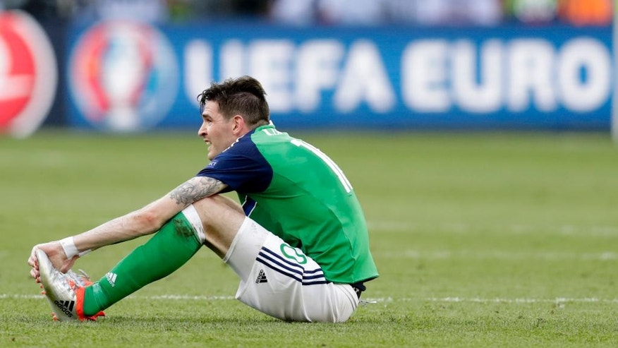 Northern Ireland's Kyle Lafferty sits on the pitch at the end of the Euro 2016 Group C soccer match between Poland and Northern Ireland at the Allianz Riviera stadium in Nice, France, Sunday, June 12, 2016. POland won 1-0. (AP Photo/Ariel Schalit)