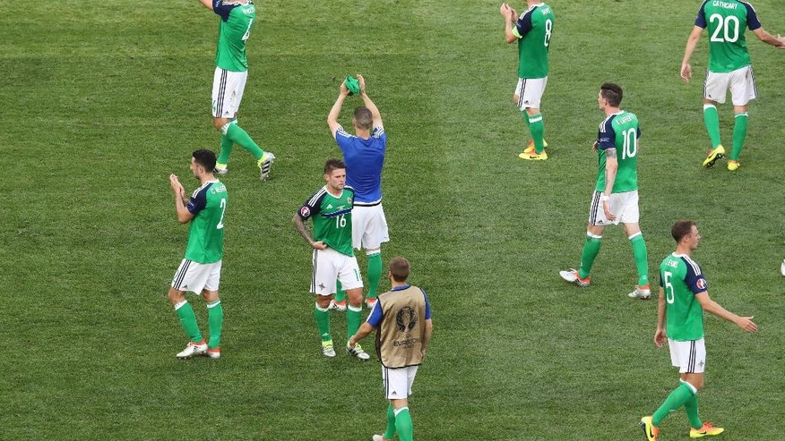 Northern Ireland players acknowledge the spectators after losing 0-1 during the Euro 2016 Group C soccer match between Poland and Northern Ireland, at the Allianz Riviera stadium, in Nice, France, Sunday, June 12, 2016. (AP Photo/Claude Paris)