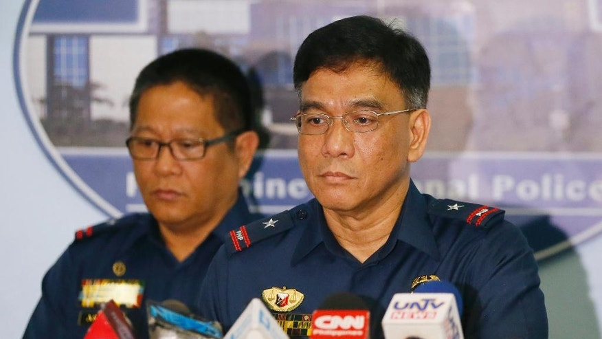 Philippine National Police Spokesman C/Supt. Wilben Mayor, right, and PNP Crime Laboratory Chief C/Supt. Emmanuel Aranas listen to questions from the media after reading the statement on the beheading of a Canadian hostage Tuesday, June 14, 2016, at Camp Crame in suburban Quezon city northeast of Manila, Philippines. Philippine officials have confirmed that Abu Sayyaf militants beheaded Canadian Robert Hall, the second Canadian hostage to be killed by Abu Sayyaf militants in two months after their demands for a large ransom were not met. (AP Photo/Bullit Marquez)
