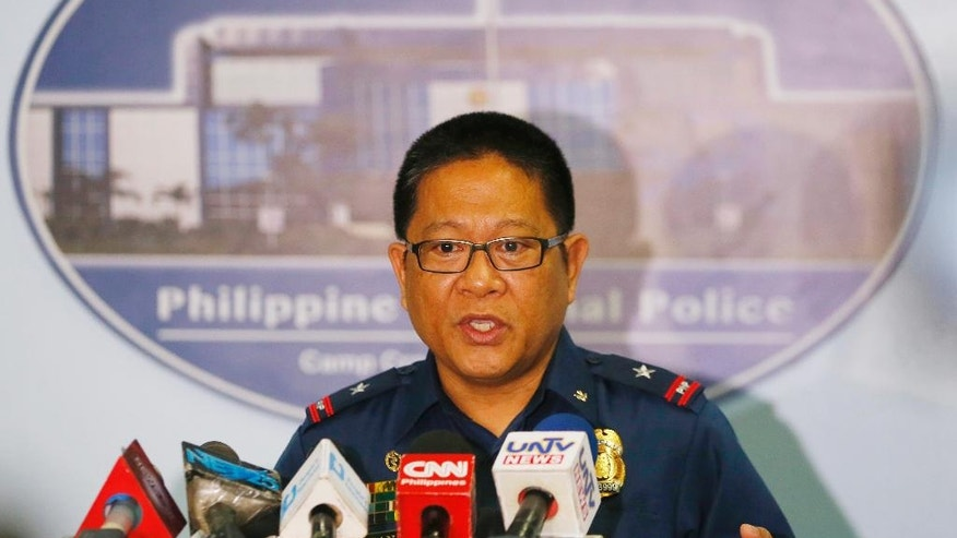 Philippine National Police Crime Laboratory Chief C/Supt. Emmanuel Aranas reads his statement on the beheading of a Canadian hostage Tuesday, June 14, 2016 at Camp Crame in suburban Quezon city northeast of Manila, Philippines. Philippine officials have confirmed that Abu Sayyaf militants beheaded Canadian Robert Hall, the second Canadian hostage to be killed by Abu Sayyaf militants in two months after their demands for a large ransom were not met. (AP Photo/Bullit Marquez)