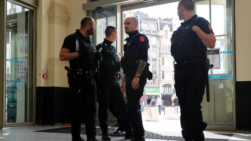 French police patrol the railway station in Lille, France, Tuesday, June 14, 2016, where Russia will play the Euro 2016 match against Slovakia. Russia coach Leonid Slutsky expects his team's fans to behave themselves in Wednesday's game against Slovakia and avoid his side being expelled from the European Championship. (AP Photo/Darko Bandic)
