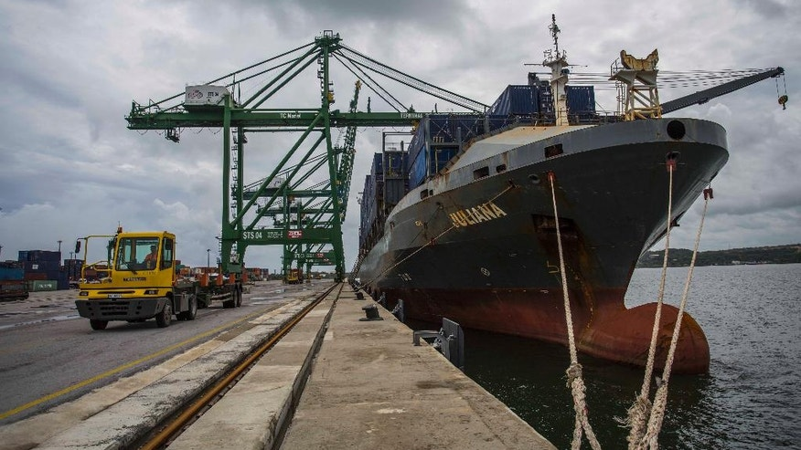 In this June 9, 2016 photo, Liberian flagged container ship named Juliana is moored in Mariel Port's special development zone near Havana, Cuba. Cuban authorities say the island needs more than $2 billion a year in foreign investment in order to drag itself out of a decades-long cycle of anemic productivity and over-dependence on imports. (AP Photo/Desmond Boylan)