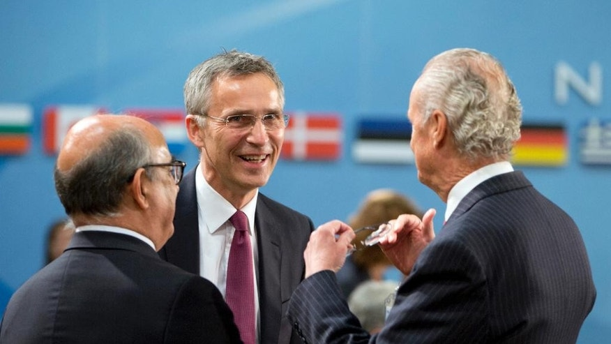 NATO Secretary General Jens Stoltenberg, center, speaks with Spanish Defense Minister Pedro Morenes Eulate, right, during a meeting of the North Atlantic Council at NATO headquarters in Brussels on Wednesday, June 15, 2016. NATO concludes a two-day meeting on Wednesday with discussions on the situation in Afghanistan and Ukraine. (AP Photo/Virginia Mayo)