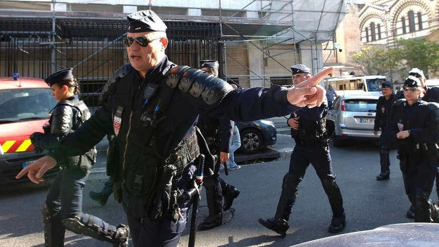 Police officers secure the front of a police station, in Marseille, France, ahead of police vans carrying soccer fans arriving, Tuesday June 14, 2016. A bus carrying Russian fans has been detained near the French city of Nice amid concerns over hooligan violence after Russian fans attacked English supporters last week. (AP Photo/Claude Paris)