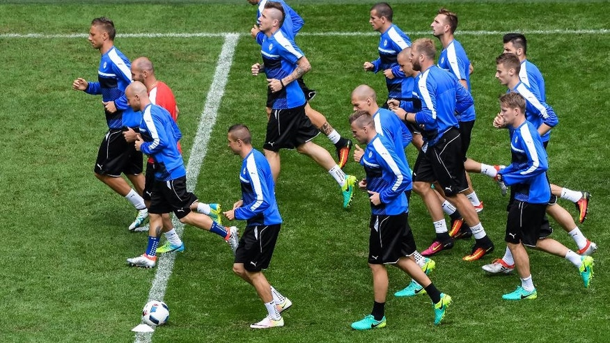 Slovakia's soccer players warm up during a training session at the Pierre Mauroy stadium in Villeneuve d'Ascq, near Lille, France, Tuesday, June 14, 2016. Slovakia faces Russia in a group B match on Wednesday June 15, 2016. (AP Photo/Geert Vanden Wijngaert)