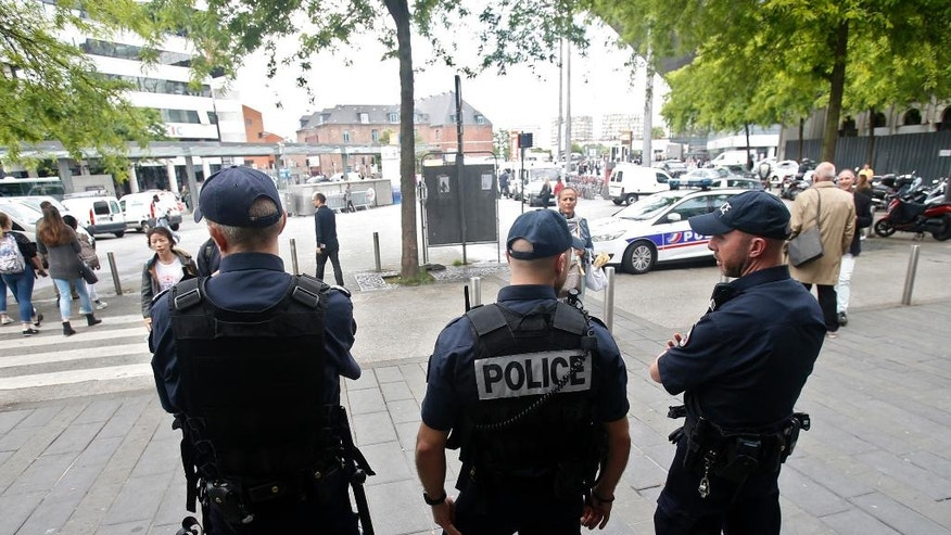 French riot police patrol in downtown Lille, France, Tuesday, June 14, 2016. UEFA's disciplinary body says Russia will be disqualified from the European Championship if there is more fan violence inside stadiums in France. Russia was charged after its fans attacked English rivals in Marseille after Saturday's 1-1 draw. (AP Photo/Darko Vojinovic)