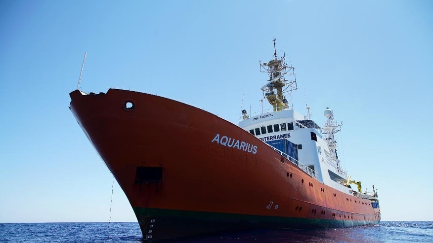 "The Aquarius, a former coast guard boat, which is used for rescuing migrants on the Mediterranean sea, as it carries out training off the Libyan coast where it has saved more than 2,200 migrants so far.  Medecins Sans Frontieres and SOS Meditarrenee personal attended a medical training course aboard the ""Aquarius"" on Tuesday. The two humanitarian organisations have joined forces on the vessel to rescue migrants on their way from North Africa to Europe.  (AP Photo/Bram Janssen)"