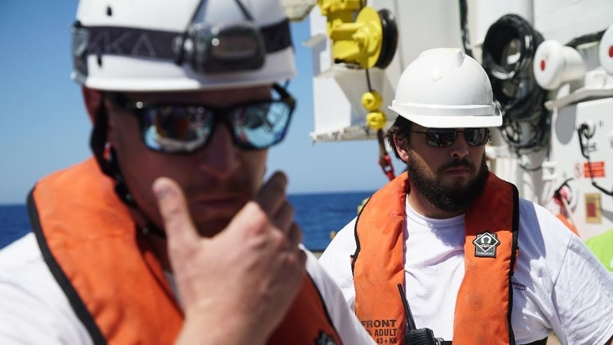 "Haydn Williams, right, the project coordinator for Medecins Sans Frontieres watches as MSF and SOS Meditarrenee personal carry out training aboard the ""Aquarius"" Tuesday June 14, 2016 in the Mediterranean Sea. The two humanitarian organisations have joined forces on the vessel to rescue migrants on their way from North Africa to Europe.  (AP Photo/Bram Janssen)"