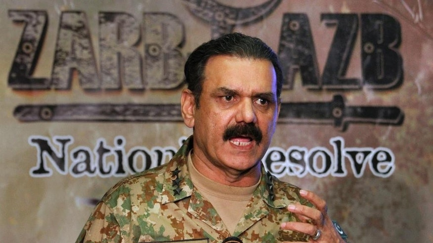 Pakistan's army spokesman Lt Gen. Asim Bajwa speaks during a press conference addressing the ongoing military offensive in tribal area's and clashes at a Pakistan-Afghan border crossing, in Rawalpindi, Pakistan, Wednesday, June 15, 2016. Renewed clashes overnight at a Pakistan-Afghan border crossing killed an Afghan border guard and wounded five, an Afghan official said Wednesday, as Islamabad dispatched more troops to the volatile boundary amid an escalation between the two neighbors. (AP Photo/Anjum Naveed)
