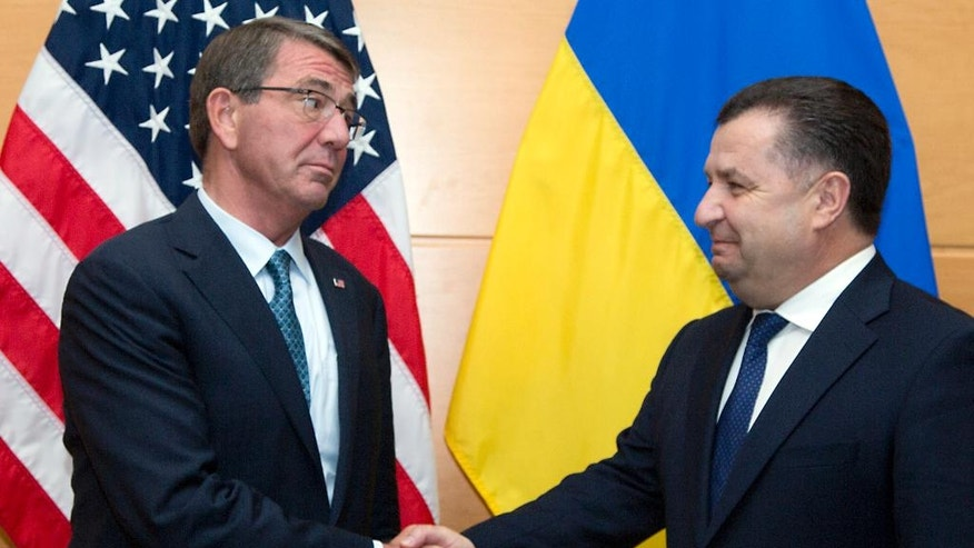 Ukraine's Defense Minister Stepan Poltorak, right, is greeted by U.S. Secretary of Defense Ash Carter prior to a meeting at NATO headquarters in Brussels on Wednesday, June 15, 2016. NATO concludes a two-day meeting on Wednesday with discussions on the situation in Afghanistan and Ukraine. (AP Photo/Virginia Mayo, Pool)