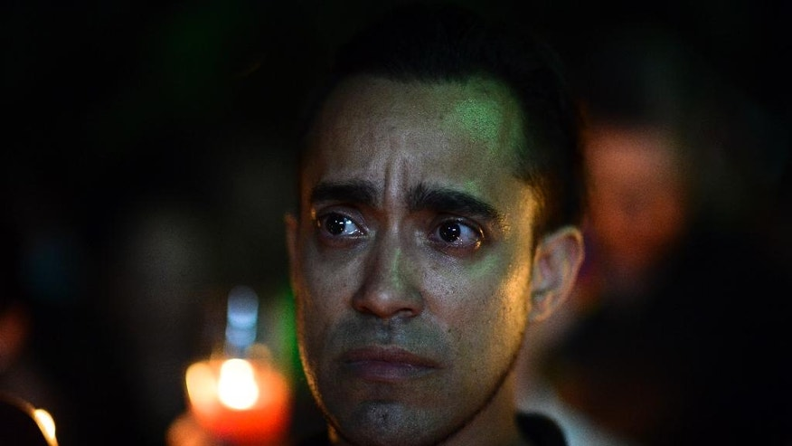A man cries during a vigil to honor the memory of the Puerto Ricans that died in the mass shooting at a nightclub in Orlando, Fla., at the Hato Rey LGBTT Community Center in San Juan, Puerto Rico, Tuesday, June 14, 2016. Dozens of people died at the 'Pulse' gay nightclub in Orlando, making it the deadliest mass shooting in modern U.S. history. (AP Photo/Carlos Giusti)